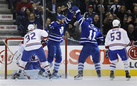 Toronto Maple Leafs' Frazer McLaren (2nd L) celebrates his goal with teammate Jay McClement (2nd R) in front of Montreal Canadiens' Travis M