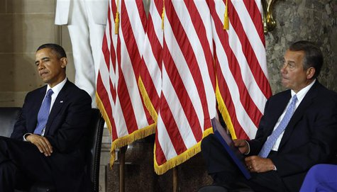 U.S. President Barack Obama and House Speaker John Boehner (R) attend the unveiling ceremony for the Rosa Parks statue in the U.S. Capitol i