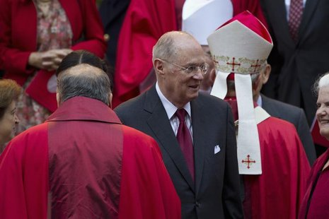 Supreme Court Justice Anthony Kennedy (C) leaves at the conclusion of the annual Red Mass held at the Cathedral of St. Matthew the Apostle i