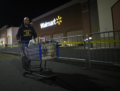 A man pushes a loaded shopping cart at a Walmart store, on Thanksgiving day in North Bergan, New Jersey November 22, 2012. REUTERS/Eric Thay