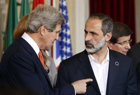 U.S. Secretary of State John Kerry (L) talks with New Syrian National Coalition head Mouaz al-Khatib during a meeting at Villa Madama in Rom