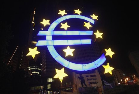 A sculpture showing the Euro currency sign is seen in front of the European Central Bank (ECB) headquarters in Frankfurt June 29, 2012. REUT
