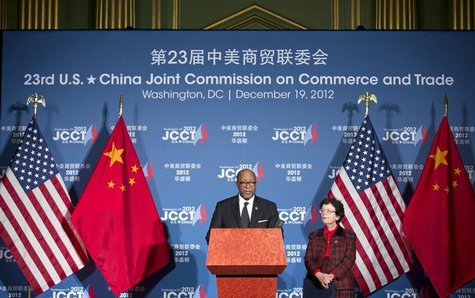 U.S. Trade Representative Ron Kirk and Acting Secretary of Commerce Rebecca Blank speak at a news conference during the 23rd session of the