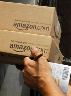 A driver delivers two packages from Amazon.com in Boston, Massachusetts in this July 26, 2011 file photo. REUTERS/Brian Snyder