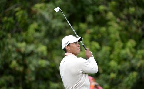 Tiger Woods of the U.S. hits the ball at the 16th tee during first round play in the Honda Classic PGA golf tournament in Palm Beach Gardens