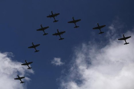 Super Tucano combat planes fly during a ceremony to mark the 93rd anniversary of the Colombian Air Force at the military base in Bogota Nove