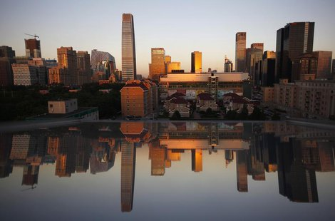 Residential and commercial buildings are seen reflected in a window during a sunset in Central Business District (CBD) of Beijing September