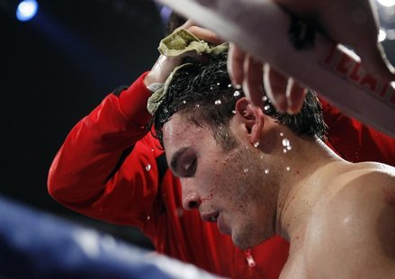 Julio Cesar Chavez Jr. of Mexico is treated in his corner between rounds during his bout against Sergio Martinez of Argentina at the Thomas