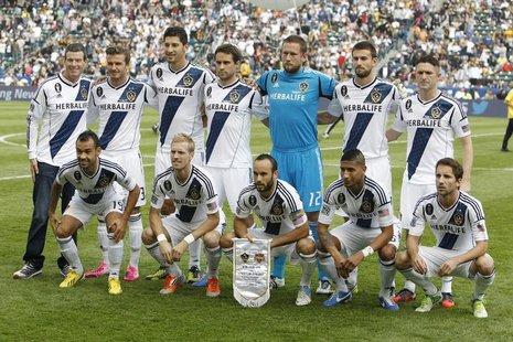 The Los Angeles Galaxy team poses before playing against the Houston Dynamo before the MLS Cup championship soccer game in Carson, Californi