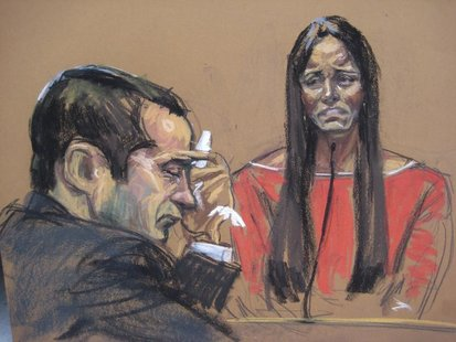 "Former New York City police officer Gilberto Valle (L), dubbed by local media as the ""Cannibal Cop"", listens as his wife Kathleen Mangan tes"