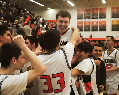 Teammates lift Fennville junior forward Wes Leonard following his game-winning shot in a 57-55 overtime win over visiting Bridgman on Mar. 3, 2011.