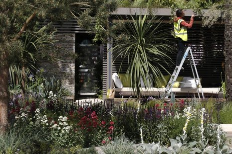 A worker prepares the Cancer Research UK Garden ahead of the opening of the Chelsea Flower Show 2011 on Tuesday, in London in this file phot