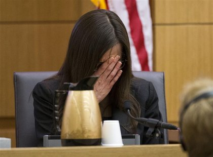 Jodi Arias breaks down after being asked by prosecutor Juan Martinez if she was crying when she stabbed Travis Alexander and when she slit h