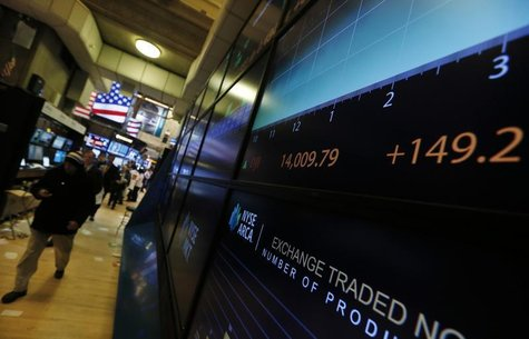 A screen on the trading floor shows the Dow Jones Industrial average after the closing bell at the New York Stock Exchange, February 1, 2013