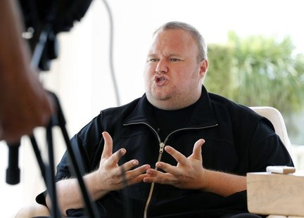 Kim Dotcom gestures as he speaks during an interview with Reuters in Auckland January 19, 2013.REUTERS/Nigel Marple