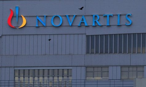 A logo is pictured on a building of Swiss drug maker Novartis before its annual general meeting in Pratteln near Basel February 22, 2013. RE