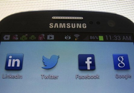A Facebook icon is shown on a Samsung Galaxy III mobile phone in this photo illustration in Encinitas, California, January 30, 2013. REUTERS