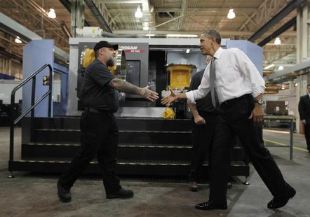 U.S. President Barack Obama meets workers as he tours Linamar Corporation, a manufacturer of parts for the truck industry in Arden, North Ca