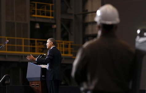 A shipyard worker listens as U.S. President Barack Obama speaks at Newport News Shipbuilding in Newport News, Virginia February 26, 2013. RE