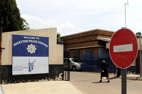 A women enters the Daveyton Police station, east of Johannesburg February 28, 2013. A video of South African police dragging a man for hundr