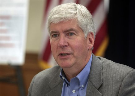 Michigan Governor Rick Snyder talks about the future of the city of Detroit during a news conference in Detroit, Michigan February 21, 2013.
