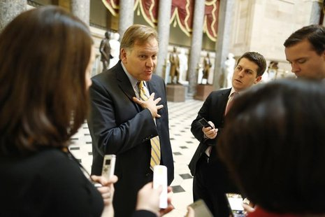 U.S. Representative Mike Rogers (R-MI) (left) talks to reporters at the U.S. Capitol in Washington in this file photo taken December 31, 201