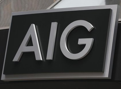 A new sign is displayed over the entrance to the AIG headquarters offices in New York's financial district, January 9, 2013. REUTERS/Brendan