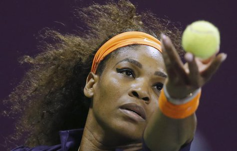 Serena Williams of the U.S. serves the ball to Victoria Azarenka of Belarus during the final match at the Qatar Open tennis tournament in Do