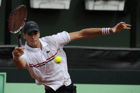 John Isner of the U.S. returns the ball to David Ferrer of Spain during their Davis Cup World Group semi-final match in Gijon, northern Spai