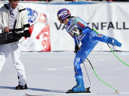 Slovenia's Tina Maze celebrates in front of a cameraman after the women's Alpine Skiing World Cup Downhill race in Garmisch-Partenkirchen Ma
