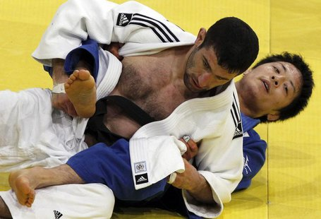 Japan's Junpei Morishita (R) challenges Armenia's Armen Nazaryan in their under-66 kg final at the Paris International grand slam judo tourn