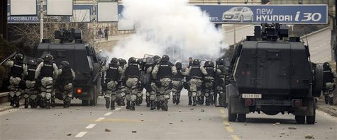 Macedonian riot police clash with ethnic Albanians during a demonstration in Skopje, March 2, 2013. REUTERS/Ognen Teofilovski