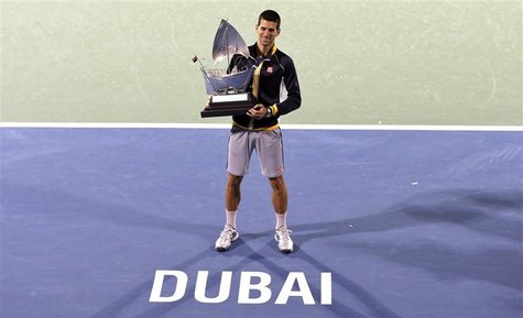 Novak Djokovic of Serbia poses with the trophy after winning his men's singles final match against Tomas Berdych of Czech Republic during th