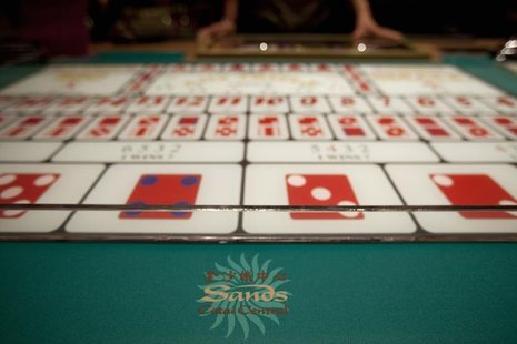 A logo of Sands is seen on a gaming table inside a casino on the opening day of the Sheraton Macao hotel at Sands Cotai Central in Macau Sep