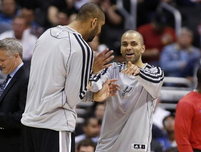 San Antonio Spurs' Tony Parker (R), of France, and Tim Duncan share a laugh against the Los Angeles Clippers during the second half of an NB