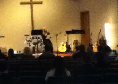 Kari Ann Steger speaks to the congregation during a prayer vigil for her sister, Kira Steger Trevino 3/1/13