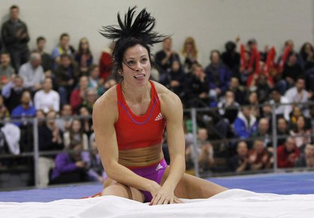 Jenn Suhr of the U.S. reacts after clearing the bar as she competes in the women's pole vault during the New Balance Indoor Grand Prix track