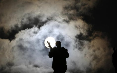 A statue is silhouetted in Saint Peter's Square at the Vatican March 3, 2013. REUTERS/Max Rossi