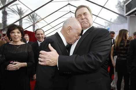 "Actors John Goodman (R) and Alan Arkin from ""Argo"" embrace at the 19th annual Screen Actors Guild Awards in Los Angeles, California in this"