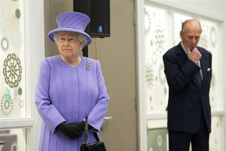 Britain's Queen Elizabeth and her husband Prince Philip pause during a tour of the Royal London Hospital in east London in a February 27, 20