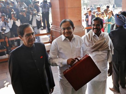 India's Finance Minister Palaniappan Chidambaram (C) arrives at the parliament to present the 2013/14 federal budget in New Delhi February 2