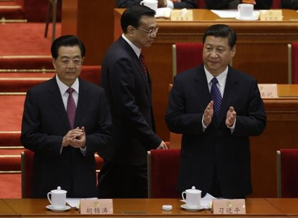 China's President Hu Jintao and China's Communist Party Chief Xi Jinping clap as China's Vice President Li Keqiang walks past before the ope