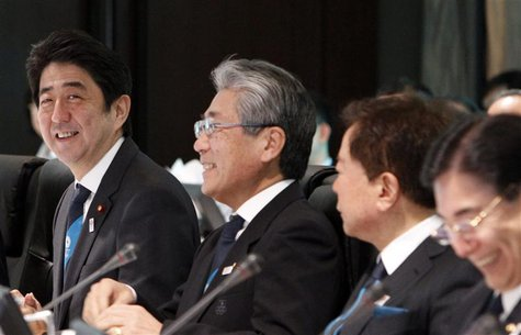 Japan's Prime Minister Shinzo Abe, Japanese Olympic Committee (JOC) President Tsunekazu Takeda and Tokyo REUTERS/Yuya Shino