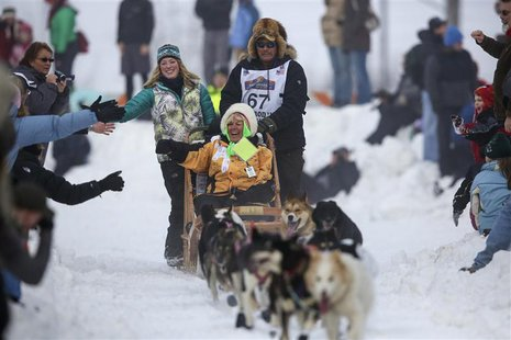 Sonny Lindner's team races down Cordova Street during the ceremonial start to the Iditarod dog sled race in downtown Anchorage, Alaska March