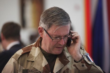 France's Chief of the Defence Staff Admiral Edouard Guillaud speaks on a mobile phone at the presidential palace in Bamako, Mali February 2,