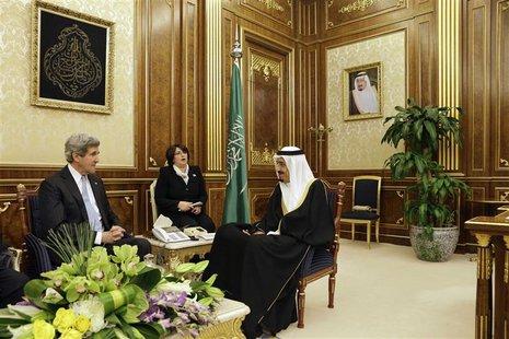 U.S. Secretary of State John Kerry (L) meets with Saudi Arabia's Deputy Foreign Minister Prince Abdulaziz bin Abdullah at Al-Yamamah Palace