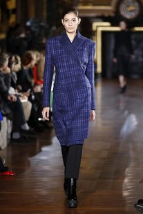 A model presents a creation by British designer Stella McCartney as part of her Fall-Winter 2013/2014 women's ready-to-wear fashion show dur