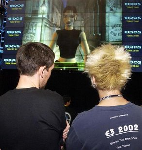 Virtual celebrity Lara Croft speaks to participants attending the 8th annual Electronic Entertainment Expo, about the anticipated release of