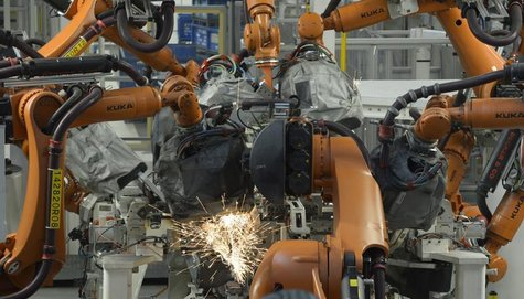 Welding robots are seen in a production line of the Golf VII car at the plant of German carmaker Volkswagen in Wolfsburg, February 25, 2013.