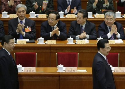 China's President Hu Jintao and China's Communist Party Chief Xi Jinping arrive for the opening ceremony of Chinese People's Political Consu